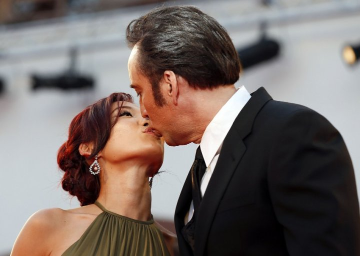 Cage kisses his wife Alice Kim on a red carpet during the 70th Venice Film Festival. (Reuters)
