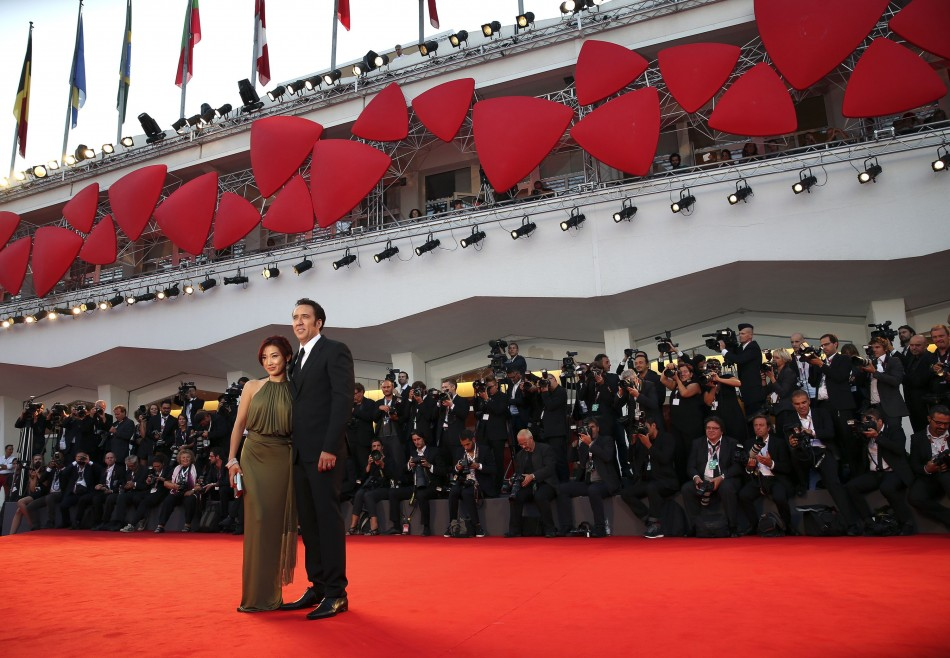 Actor Nicolas Cage and his wife Alice Kim pose on the red carpet during the 70th Venice Film Festival in Venice. Cage and Kim wedded in 2004. (Reuters)