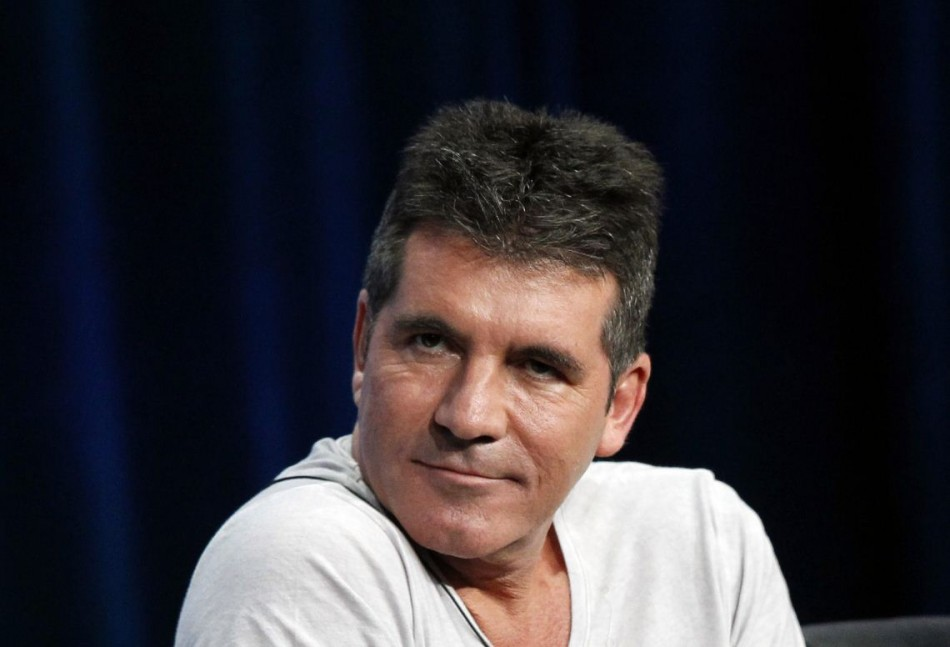 Simon Cowell's Wedding Plans Underway/Reuters