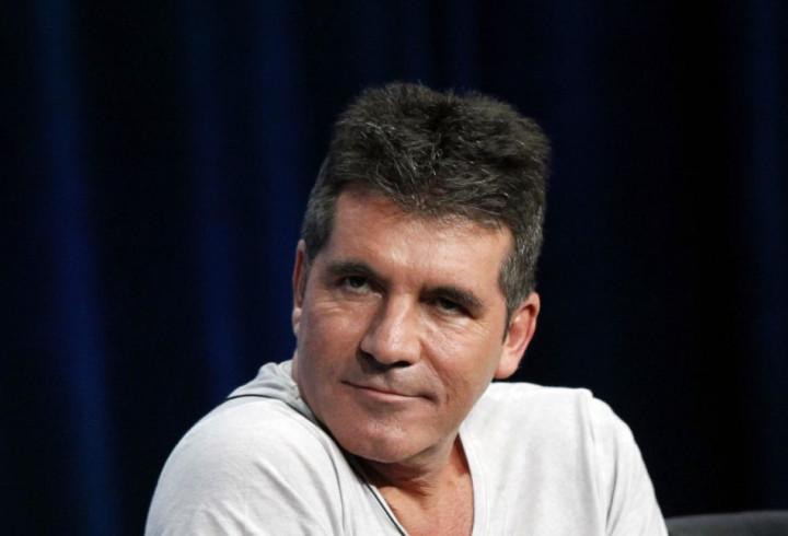 Simon Cowell's Wedding Plans Underway/Reuters