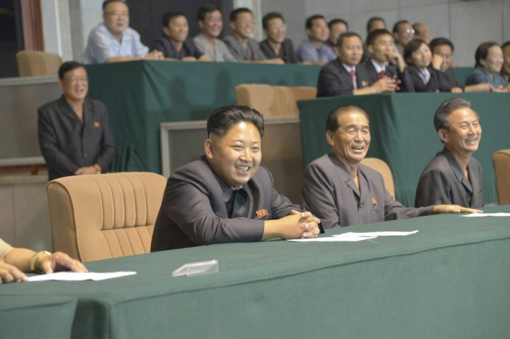 Kim Jong-un (c) watches a football match with senior generals, with former chief Kim Kyok-sik conspicuous by his absence.
