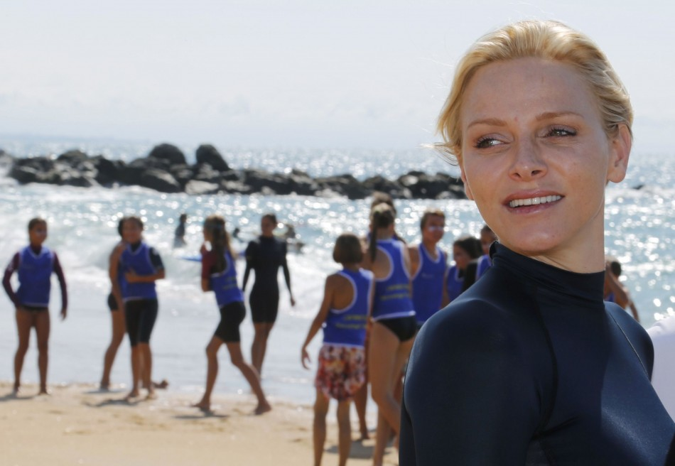 Princess Charlene of Monaco walks on the beach during a swimming event for her foundation in Capbreton, Southwestern France, September 1, 2013. (REUTERS/Regis Duvignau)