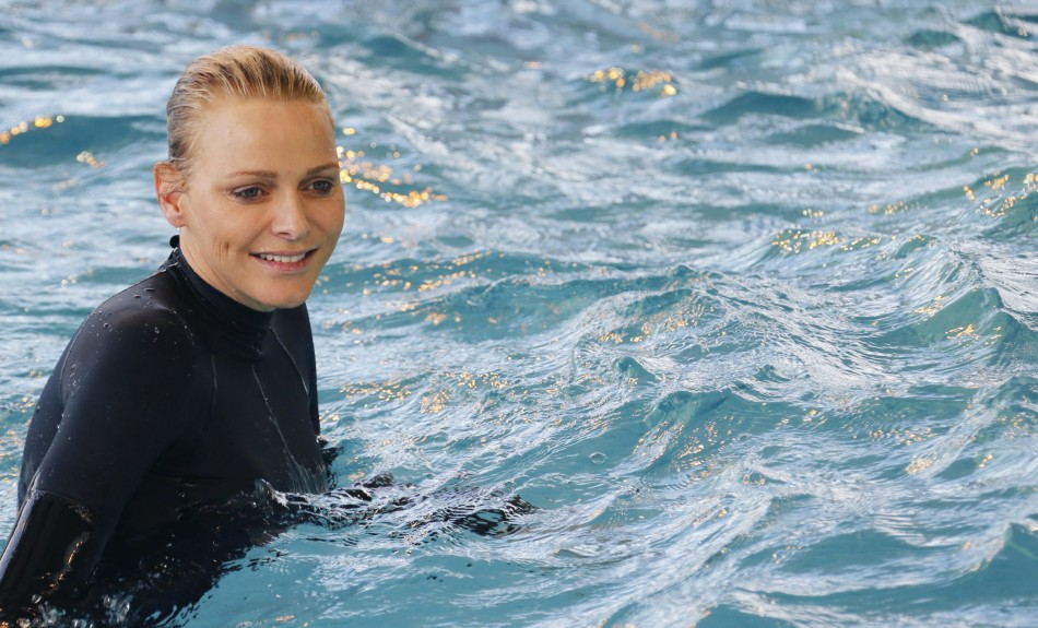 Princess Charlene looked ecstatic as she reunited with her passion for swimming.  (REUTERS/Regis Duvignau)