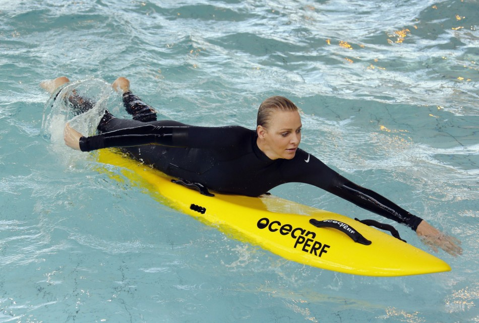 Princess Charlene of Monaco paddles during the swimming event for her foundation. (REUTERS/Regis Duvignau)