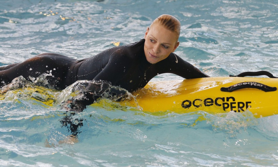 Besides teaching children, she took some time out to enjoy the waters. (REUTERS/Regis Duvignau)