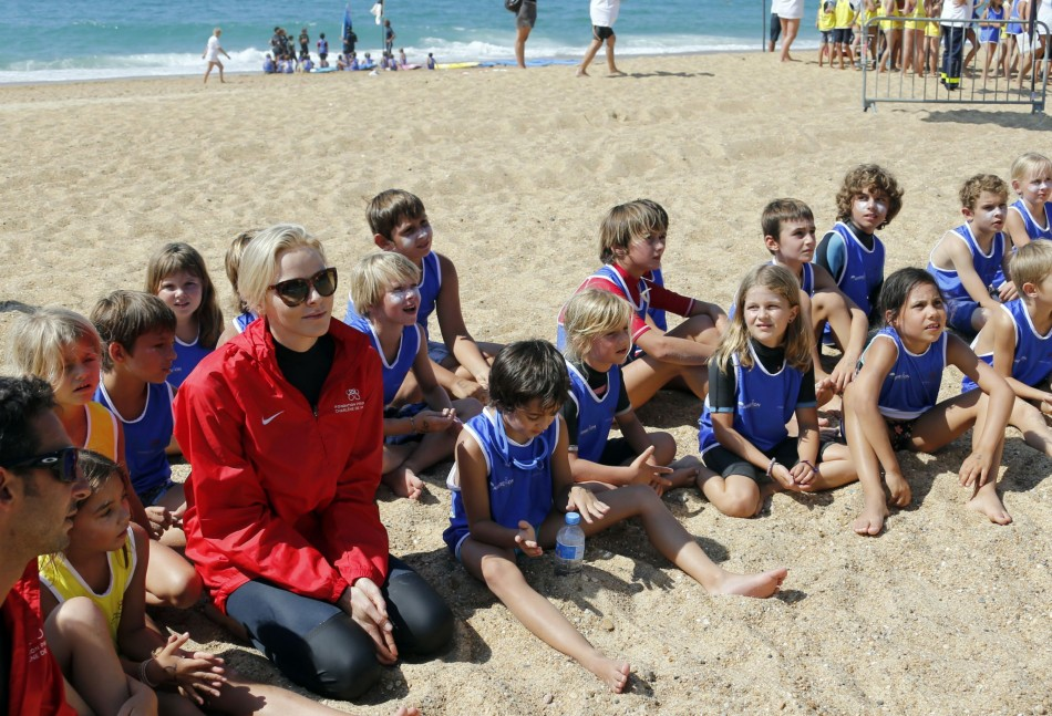 Princess Charlene of Monaco speaks with children during the event for her foundation in Capbreton, Southwestern France, September 1, 2013. (REUTERS/Regis Duvignau)