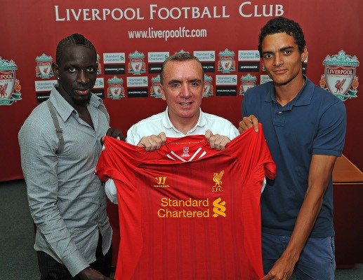 Liverpool defenders Sakho (left) and Ilori (right) with managing director Ian Ayre (centre). (Photo: Liverpool FC)