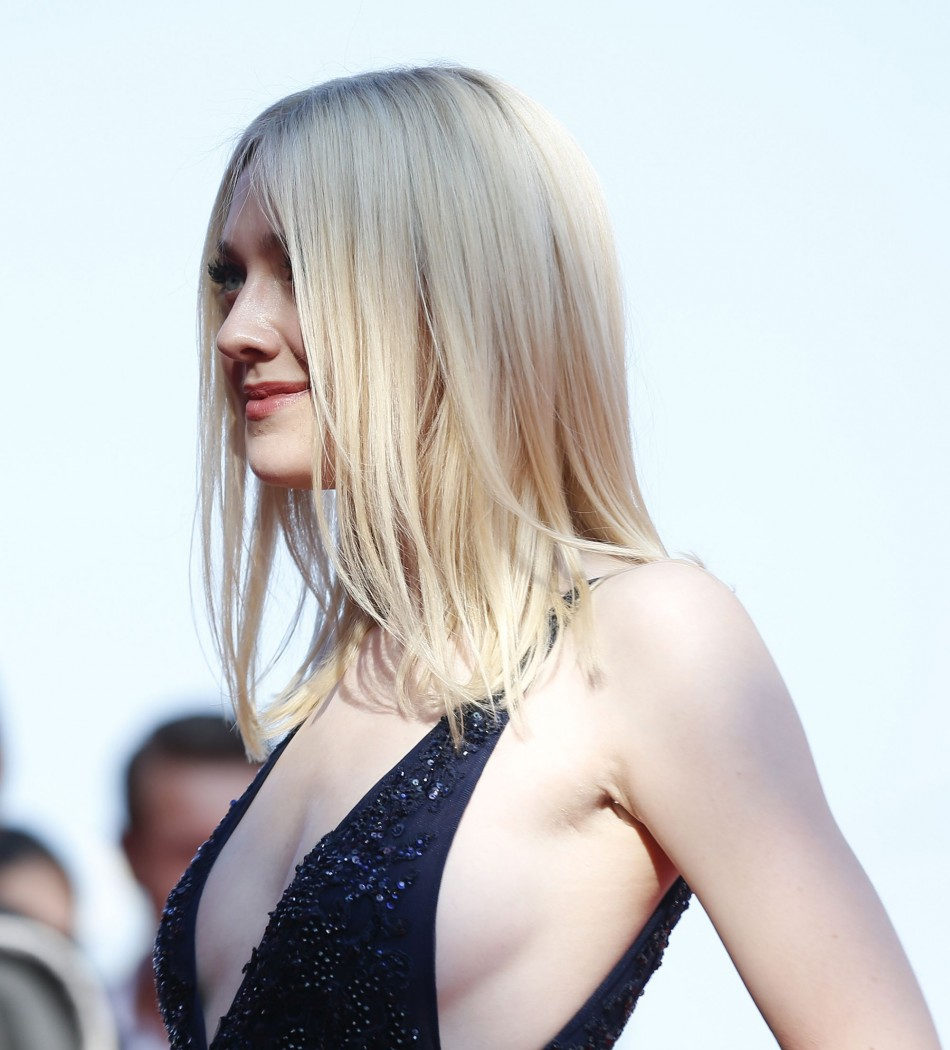 Fanning wore a gown with large armholes for the red carpet gala. (REUTERS/Alessandro Bianchi )