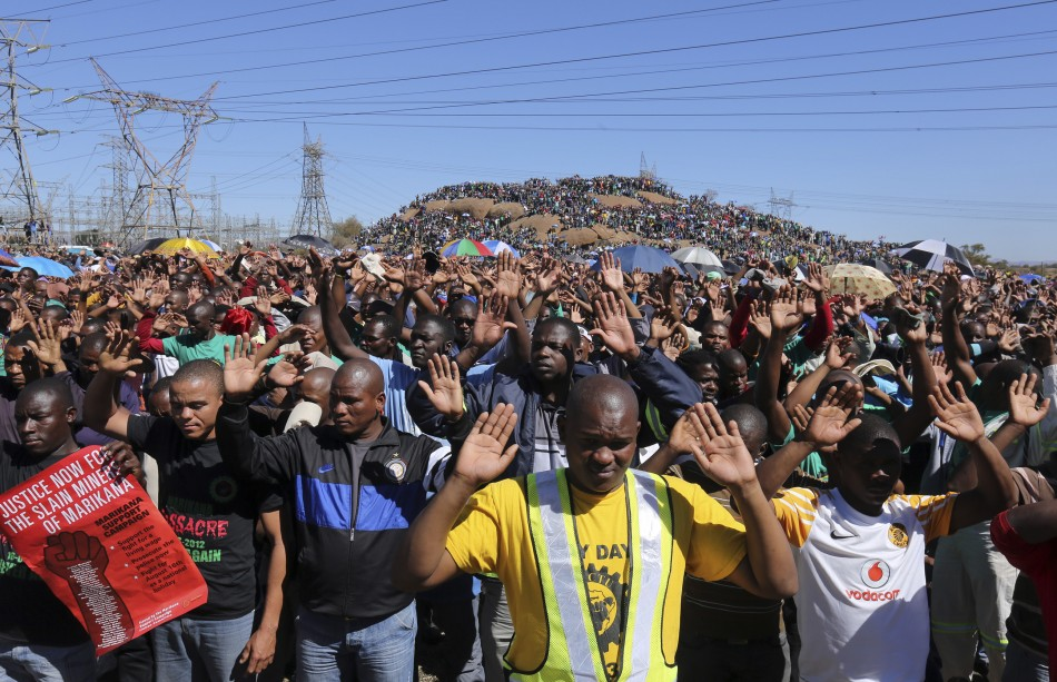 Miners congregate at the Marikana mines one year on from shooting