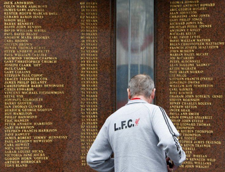 A Liverpool supporter looks at the names engraved on the Hillsborough memorial outside the club's Anfield stadium (Reuters)