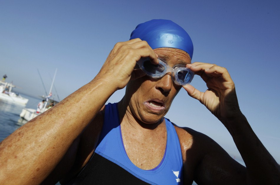 Swimmer Diana Nyad adjusts her goggles before attempting to swim to Florida from Havana (Reuters)