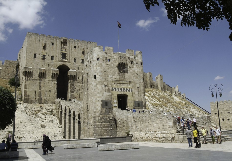 A man walks past the entrance of the Citadel of Aleppo in northern Syria on June 23, 2010, before the Syrian civil war began. (REUTERS/Khaled al-Hariri)