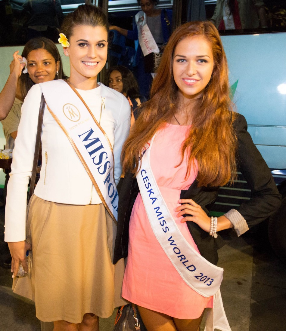 Miss Poland 2013, Katarzyna Krzeszowska, and Miss Ceska after receiving welcome flower in Bali, Indonesia, on 3 September, 2013. The month-long Miss World 2013 pageant has begun in Indonesia. (Photo: Miss World Indonesia 2013)