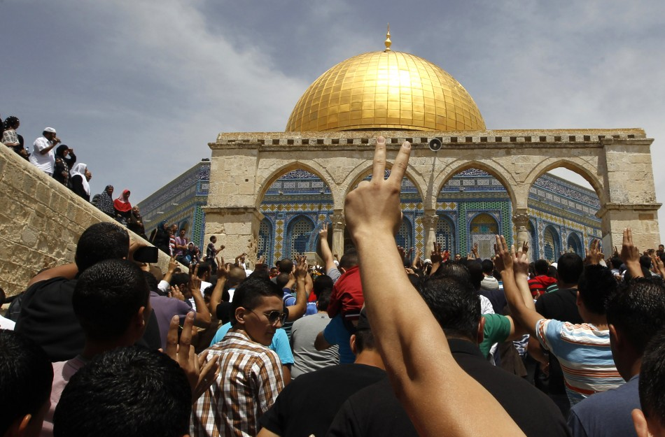 Palestinians take part in a protest after Friday prayers