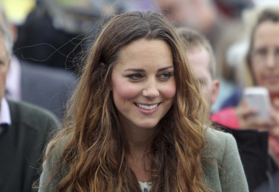 Catherine, Duchess of Cambridge visits the Breakwater country park, to start the Ring O Fire ultra marathon, in Anglesey, north Wales August 30, 2013.  Though chubby cheeked, Kate Middleton has lost most of her pregnancy and post-baby weight much sooner t