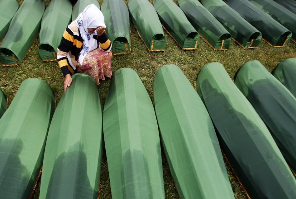A Bosnian woman cries beside the coffin of a relative, which is one of the 409 coffins of newly identified victims from the 1995 Srebrenica massacre