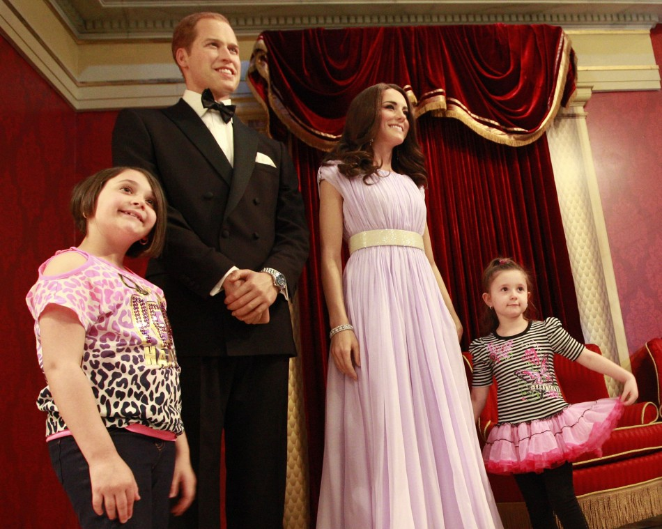 At Madame Tussauds in New York, Kate's wax statue wears the same gown she wore to an event in Los Angeles in 2011. Her figure in the same dress will be unveiled in Washington on 12 September. (REUTERS/Brendan McDermid)