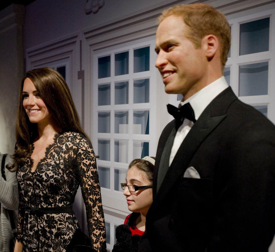 Visitors pose with waxwork models of royal couple at Madame Tussauds in Amsterdam April 4, 2012. (Reuters)