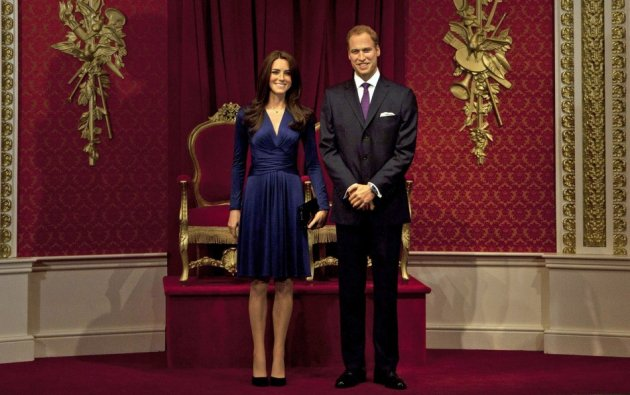 Waxwork models of Britain's Prince William and his wife Catherine, Duchess of Cambridge are unveiled at Madame Tussauds in London April 4, 2012. (REUTERS/Olivia Harris)