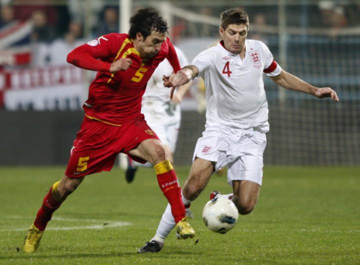 Vladimir Volkov (L) and Steven Gerrard