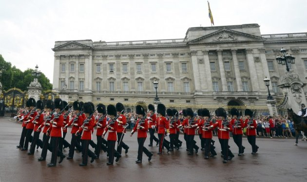 The changing of the guard ceremony at Buckingham Palace.