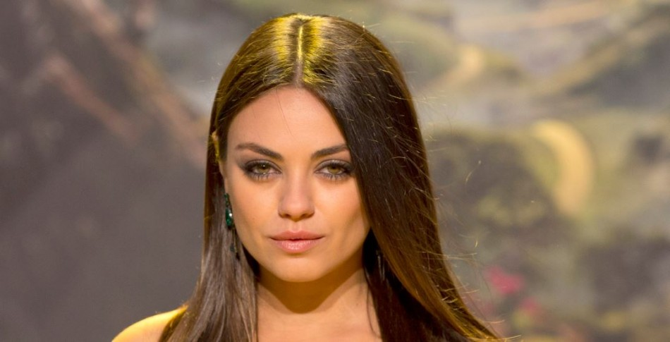 Mila Kunis sparked reports that she is engaged to Ashton Kutcher after she was spotted wearing a ring on the ring finger.