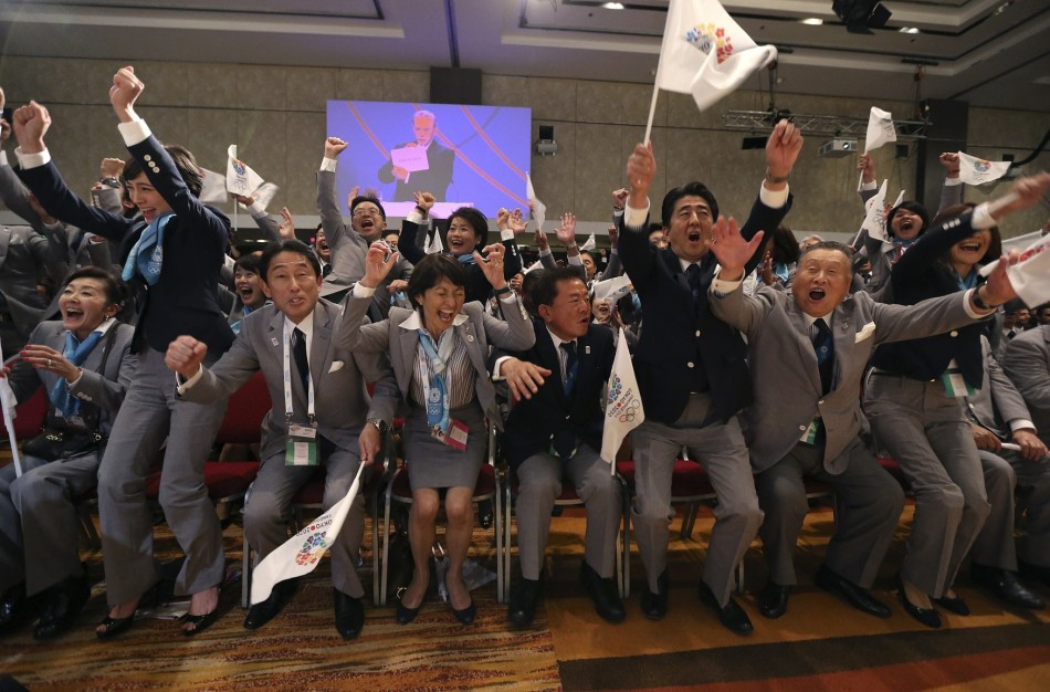 Japanese prime minister Shinzo Abe (2nd right0 celebrates Tokyo being awarded the 2020 Olympic Games.