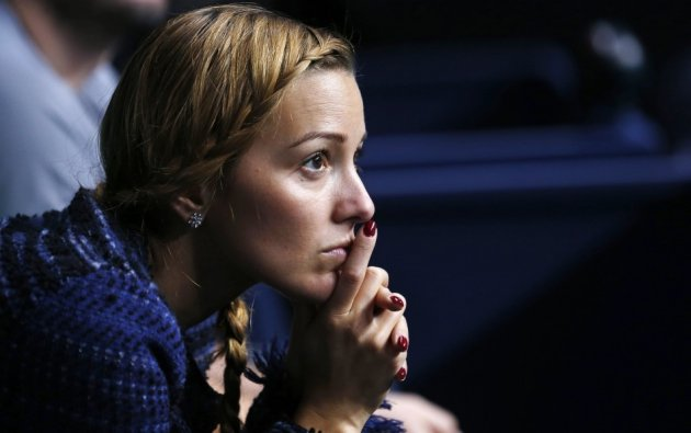 Jelena Ristic watches Djokovic's men's singles final match against Rafael Nadal of Spain at the Australian Open tennis tournament in 2012.