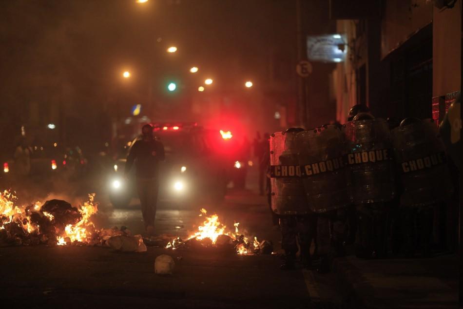 Police in Rio battle protesters near the city's administrative centre.