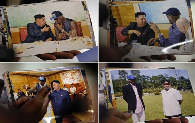 Dennis Rodman shows pictures he took with North Korean leader Kim Jong-un to the media (Reuters)