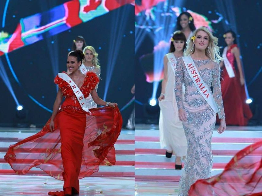 Miss World Aruba 2013 and Miss World Australia 2013 gesture as they catwalk during the opening ceremony of Miss World 2013 pageant. (Photo: Miss World/Facebook)