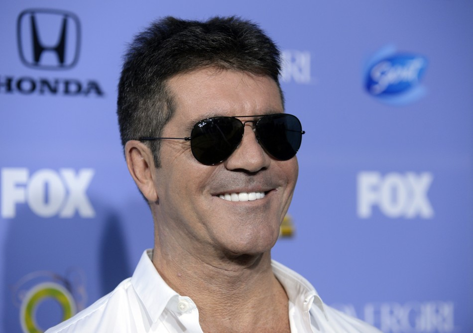 Simon Cowell has plenty to smile about after pocketing a fortune for X-Factor PIC: Reuters