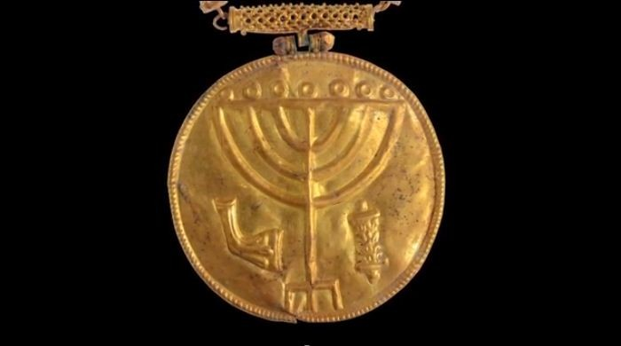 A 10-cm wide gold medallion discovered in Hebrew University excavations at the foot of the Temple Mount in Jerusalem. (Photo: Ouria Tadmor/The Hebrew University of Jerusalem)
