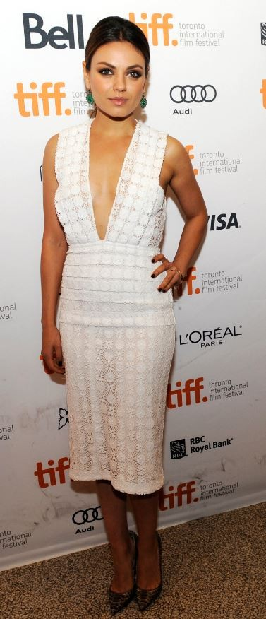 Mila Kunis poses on the red carpet before a screening of her film Third Person at the Visa Screening Room during the 38th Toronto International Film Festival in Toronto September 9, 2013.