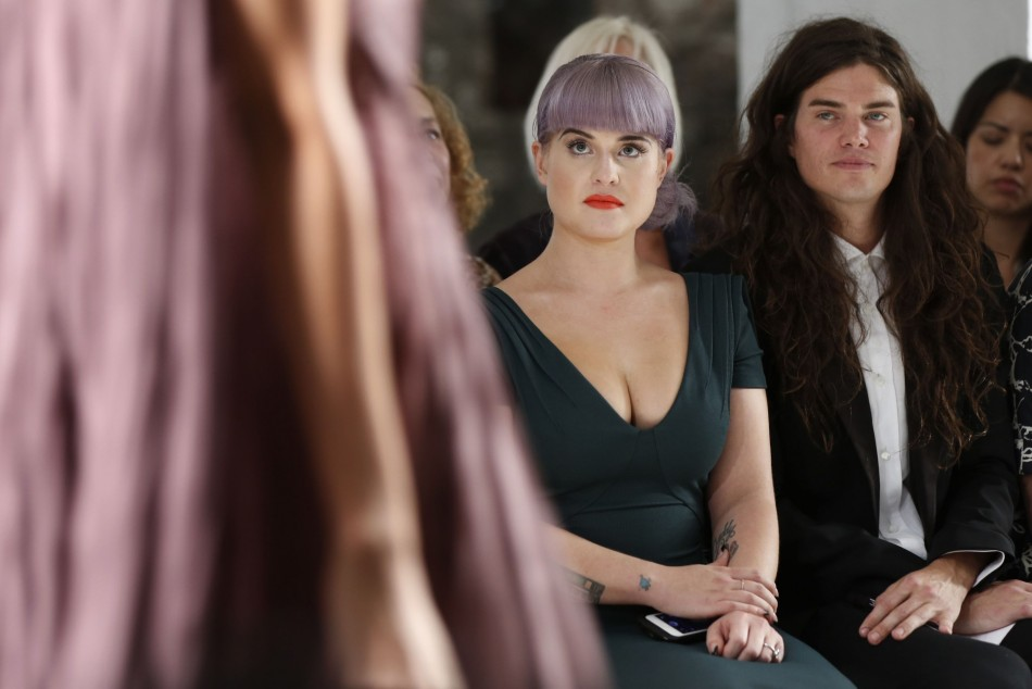 Actress Kelly Osbourne and her fiance Matthew Mosshart (R) watch models present creations from Zac Posen's Spring/Summer 2014 collection during New York Fashion Week, September 8, 2013. (REUTERS/Lucas Jackson)