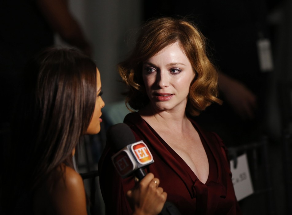 Actress Christina Hendricks talks to the media before the presentation of the Carolina Herrera Spring/Summer 2014 collection. (REUTERS/Lucas Jackson)