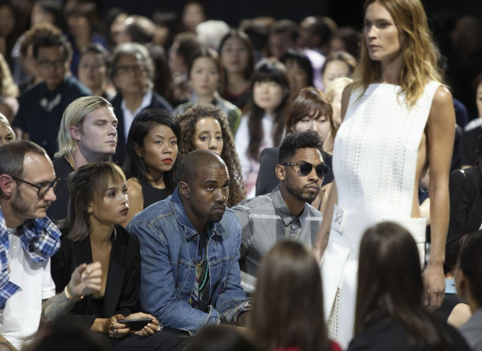From L-R: Photographer Terry Richardson, an unidentified woman, rapper Kanye West and singer Miguel watch the Alexander Wang Spring/Summer 2014 collection. (REUTERS/Lucas Jackson)