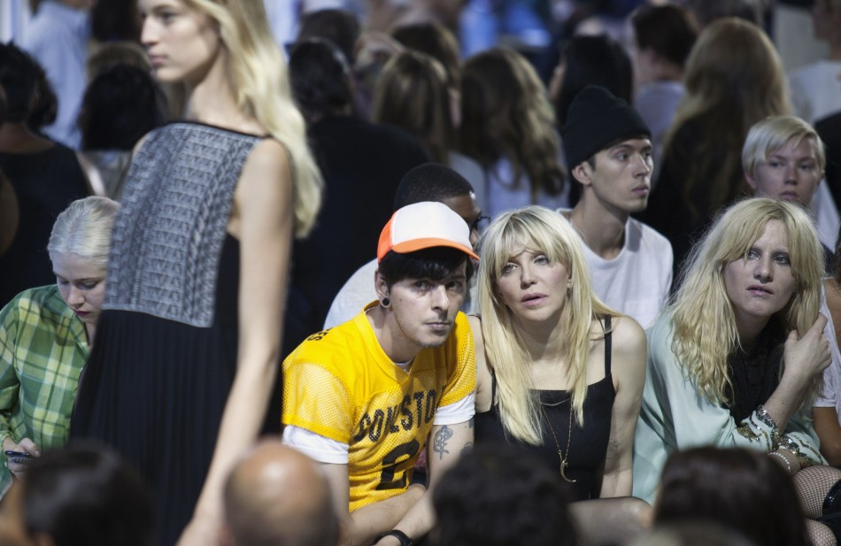 Singer Courtney Love watches the Alexander Wang Spring/Summer 2014 collection. (REUTERS/Lucas Jackson)