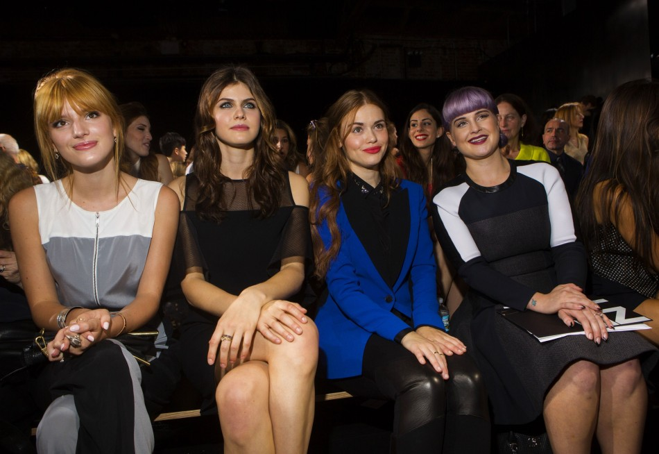 Actresses Bella Thorne (L-R), Alexandra Daddario, Holland Roden and Kelly Osbourne attend the DKNY Spring/Summer 2014 collection show. (REUTERS/Lucas Jackson)