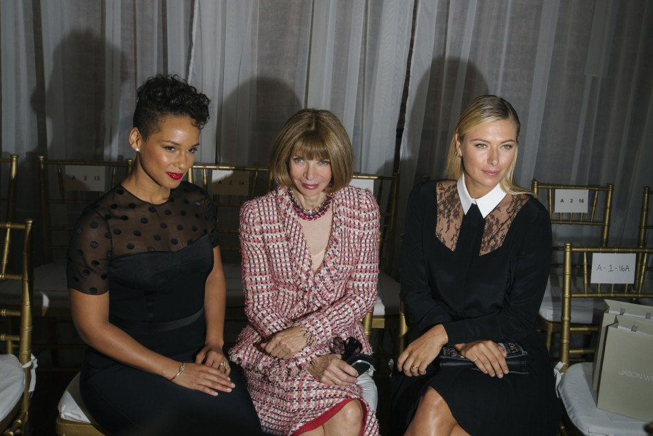 Vogue editor Anna Wintour (C) sits with tennis player Maria Sharapova (R) and singer Alicia Keys before a presentation of the Jason Wu Spring/Summer 2014 collection. (REUTERS/Lucas Jackson)