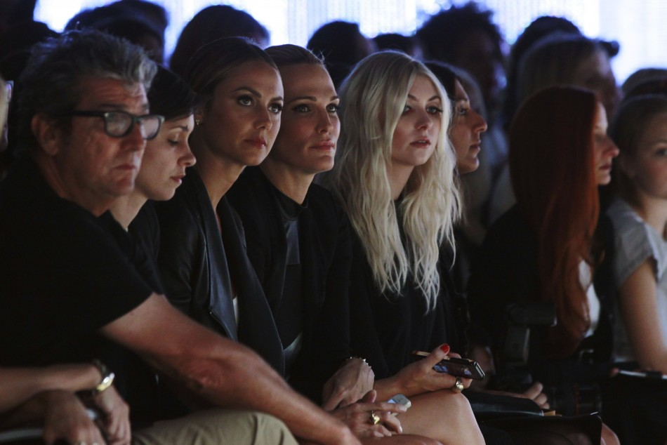 Stacy Keibler (3rd L) and actresses Molly Sims (C) and Taylor Momsen (5th L) watch a presentation of the Helmut Lang Spring/Summer 2014 collection. (REUTERS/Lucas Jackson)