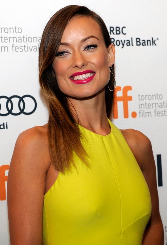 Olivia Wilde poses on the red carpet before the screening of Third Person during the 38th Toronto International Film Festival in Toronto September 9, 2013.