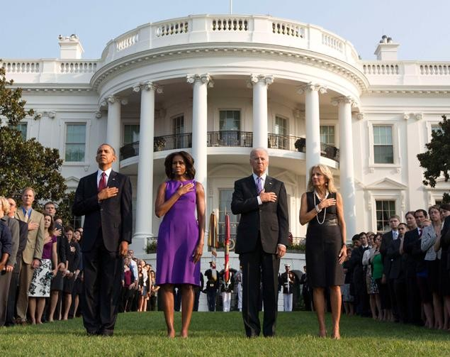 The Obamas and Bidens, along with White House staff, pay respect to 9/11 victims (Reuters)