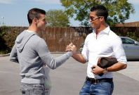 Gareth Bale and Christiano Ronaldo greet each other at Real Madrid car park PIC: Real Madrid