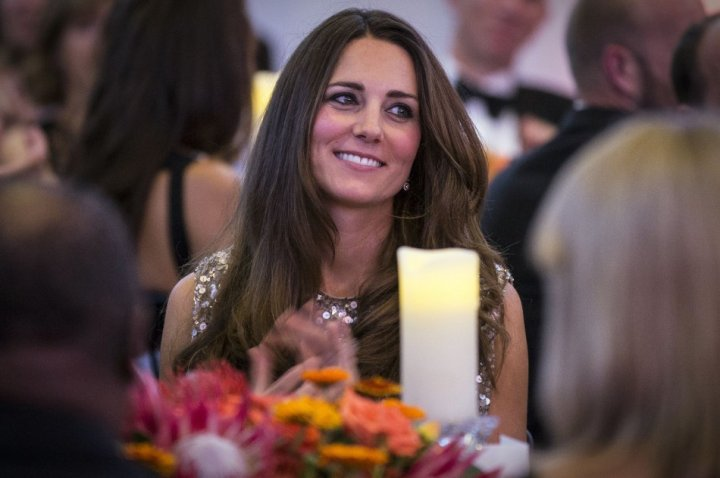 Kate Middleton basks in the glow of motherhood as she attends the charity dinner gala. (Reuters)