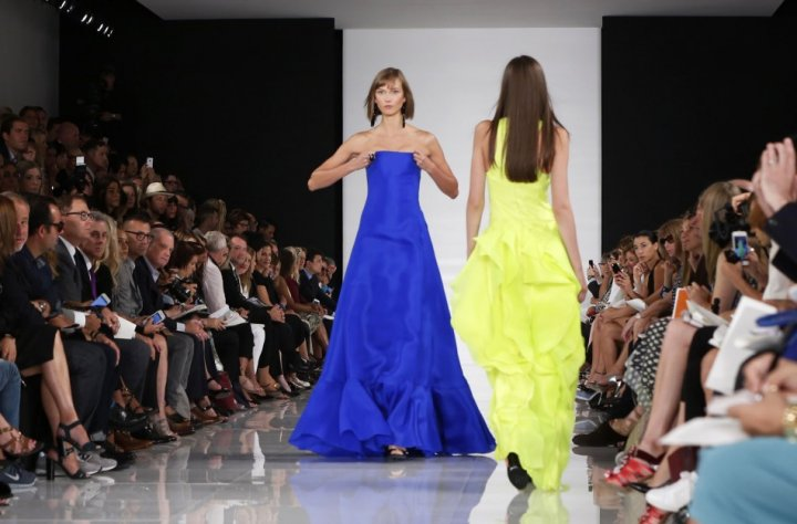 Model Karlie Kloss (L) adjusts her dress as she presents a creation from the Ralph Lauren Spring/Summer 2014 collection. (REUTERS/Lucas Jackson)