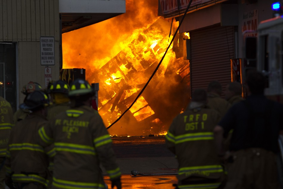 New Jersey firefighters work to control a massive fire in Seaside Park in New Jersey