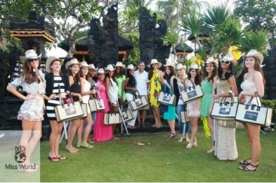 Miss World contestants parade before releasing baby turtles into the wild.