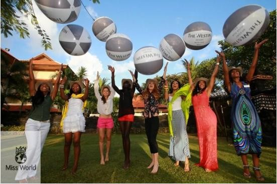 Miss World contestants throw balloons into the air before releasing baby turtles into the wild.