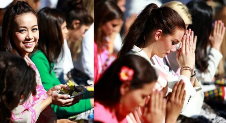 Miss World Hong Kong China (L) and Miss World Denmark (R) along with all 130 contestants of Miss World 2013 pageant took part in various religious rituals at the temple. (Photo: Miss World/Facebook)